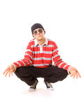 Teenager in sunglasses sitting on the floor. Old school teenager in sunglasses sitting on the floor. isolated on white Stock Photo