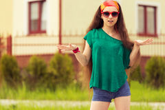 Teenager on sunglasses  in street Stock Image