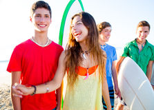 Teenager surfers boys and girls group happy Stock Image