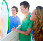 Teenager surfers group happy in beach shore Stock Images
