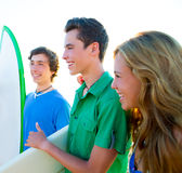 Teenager surfers group happy in beach shore Royalty Free Stock Image