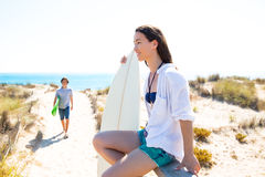 Teenager surfers waling to the beach. Teenager surfers walking to the beach in sunny summer day Royalty Free Stock Photos