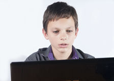 Teenager surfing the net ,over white background. Royalty Free Stock Photo