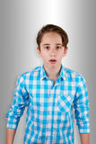 Teenager. Surprised or Scared Teenager  on Grey Background Royalty Free Stock Image