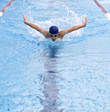 Teenager swimmer. In a butterfly stroke stock image