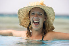 Teenager in a swimming pool Royalty Free Stock Photo