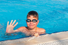 Teenager swims in pool Royalty Free Stock Images