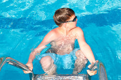 Teenager swims in pool. Action, active Stock Photos