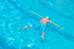 Teenager swims in pool. Action, active Royalty Free Stock Images