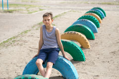 A teenager in a t-shirt is engaged on the obstacle course Stock Image