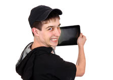 Teenager with Tablet Computer. Happy Teenager with Tablet Computer Isolated on the White Background Stock Photography