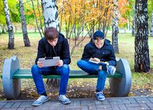 Boys reading outdoor Stock Photography
