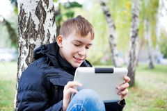 Teenager with Tablet Computer Stock Images