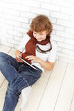 Teenager with tablet pc indoors Royalty Free Stock Photo