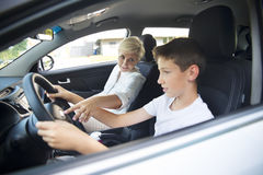 Teenager taking a driving lesson Stock Photography