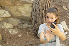 Teenager taking photos with your mobile Royalty Free Stock Photography