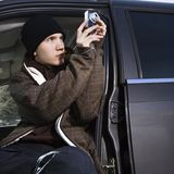 Teenager taking a picture. Royalty Free Stock Photo