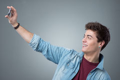 Teenager taking selfies with mobile phone Royalty Free Stock Photos