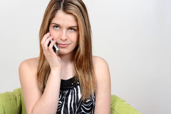 Teenager talking on cell phone Stock Photography