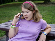 Teenager talking on mobile. Closeup of teenager talking on mobile telephone outdoors Royalty Free Stock Photos