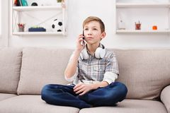 Teenager has phone talk in living room at home Royalty Free Stock Photo