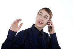 Teenager talking on the phone. Happy teenager talking on the phone on white background Royalty Free Stock Photo