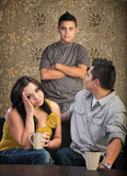 Teenager Talking to Annoyed Parents. Sitting stock photos