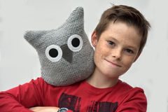 Teenager with textile owl Stock Photo