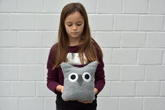 Teenager with textile owl Stock Photography