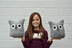 Teenager with textile owls Stock Images