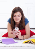 Teenager texting instead of learning Royalty Free Stock Photography