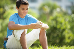 Teenager texting on the phone. Stock image of a young Hispanic teenager texting on the phone Royalty Free Stock Photography