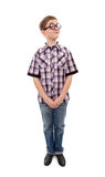 Fun teenage boy in glasses. Teenager with thick glasses on makes a funny face Royalty Free Stock Images