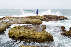 A teenager thinking and contemplating the ocean Royalty Free Stock Image