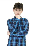 Teenager thinking. Teenager wearing shirt thinking isolated on white background Royalty Free Stock Photo
