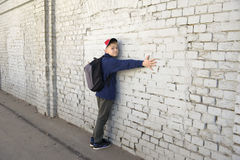 Teenager with a thoughtful look. Background brick wall Stock Photography