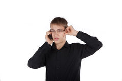 Teenager thoughtfully talking on the phone Stock Image