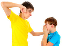 Teenager threaten a Kid. Isolated on the White Background royalty free stock photography
