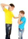 Teenager threaten Kid. Teenager threaten a Kid on the White Background royalty free stock photos