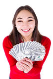 Teenager Thrilled With Money. Holding big bucks in her hands happily, all one hundred dollar banknotes. Isolated on white background Stock Image
