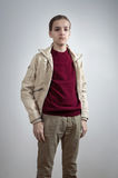 Teenager with thumbs in pockets Royalty Free Stock Photo