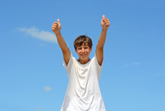 Teenager with thumbs up royalty free stock photo