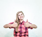 Teenager thumbs up stock photo
