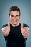 Teenager with Thums Up. Over a Grey Background Stock Image