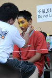 Teenager with tiger face painting. Anonymous teenager painting their face with tiger grafitti to celebrate the chinese new year event at FGS, Jenjarom Malaysia Stock Images