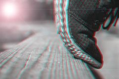 A Teenager Tiptoes On A Wooden Balancing Beam Ready To Jump At The School Training Yard On a Summer Day. Trendy 3d Anaglyph Effect.  stock photo