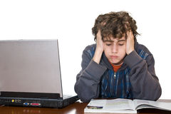 Teenager tired studying for examination Stock Image