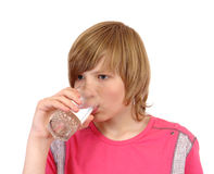 Teenager to drink water Royalty Free Stock Images