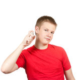 The teenager to a red T-shirt. Teenager spraying fragrance perfume. Portrait on a white background Stock Images