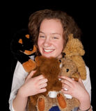 Teenager with toy animals Stock Images